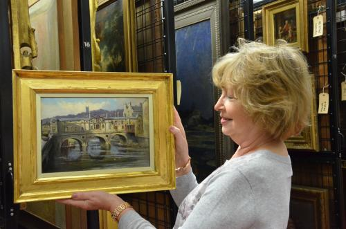 Image: Christine Milne with the restored adopted painting of 'Pulteney Weir' by John Fullylove