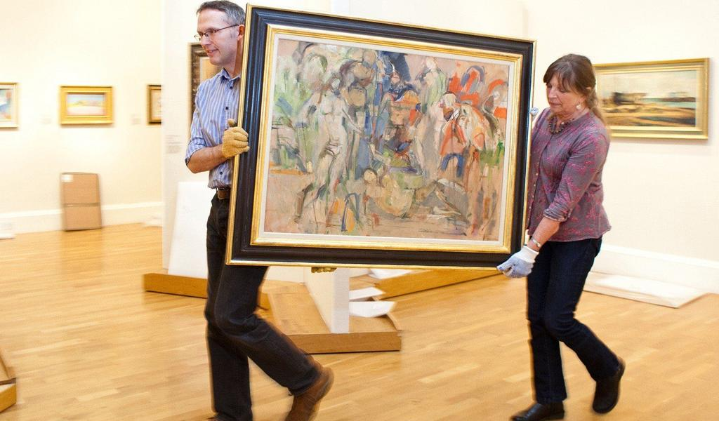 Image: Staff preparing for a new exhibition