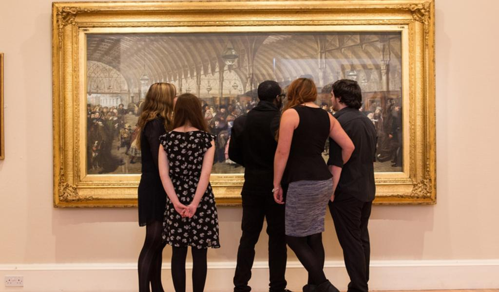 Image: A group studying a painting