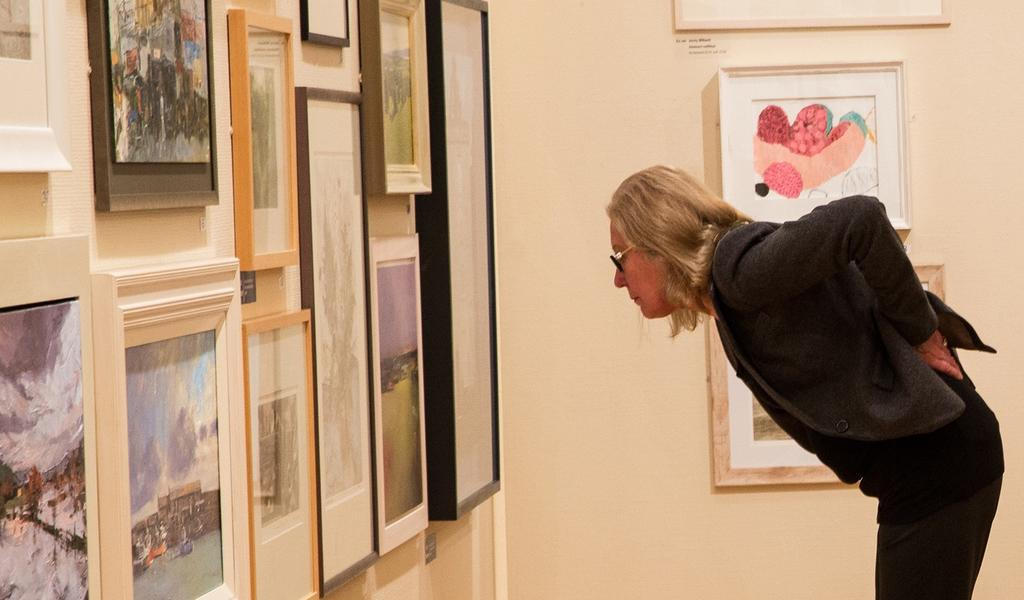 Image: Visitor viewing a painting in the Gallery