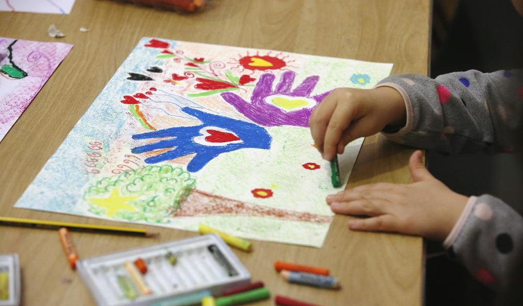 Image: A child taking part in a craft activity