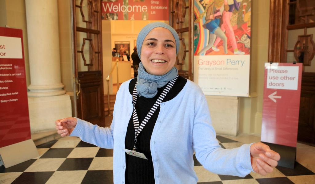 Image: A volunteer welcoming visitors to the Gallery