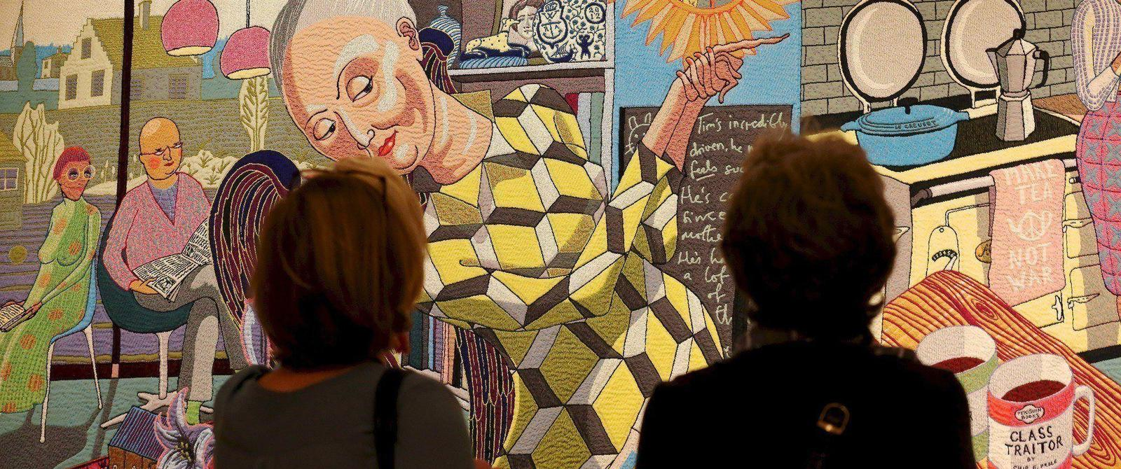 Image: Visitors viewing The Vanity of Small Differences, Grayson Perry