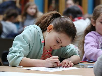 Image: Child taking part in a family activity