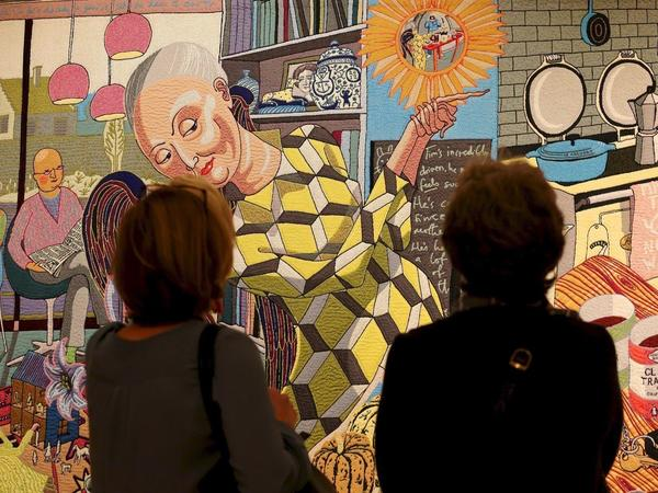 Images: Visitors viewing The Vanity of Small Differences, Grayson Perry