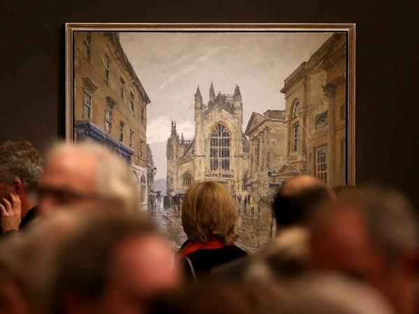 Image: Visitors viewing a Peter Brown exhibition